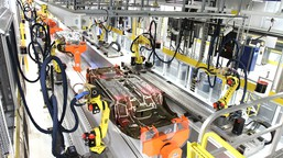 Robots work on the underbody sealing of a 2015 Chrysler 200 inside the paint shop at Chrysler Group's Assembly Plant