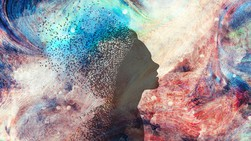 The silhouette of a head over a watercolour background
