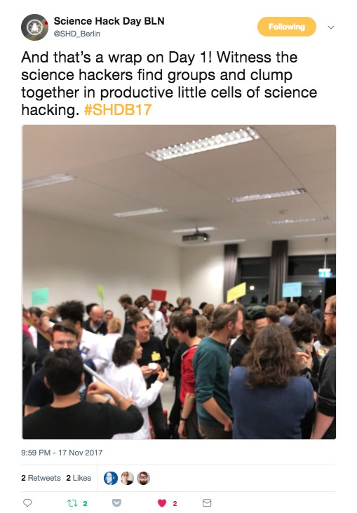 Embedded tweet about event with photo of people assembled in room