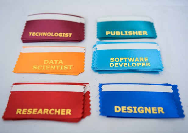 Six coloured name badge ribbons with job roles printed on