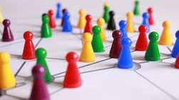 Coloured playing pieces placed on drawn network map
